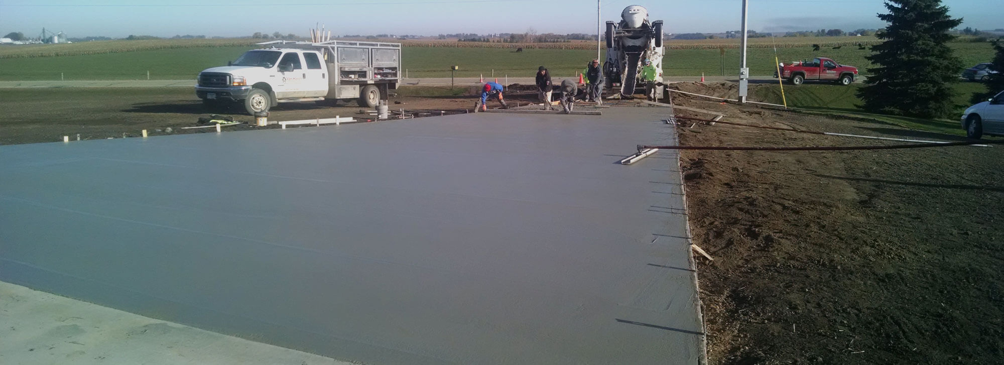 Residential concrete driveway in the process of being poured and smoothed by Van Haren Construction