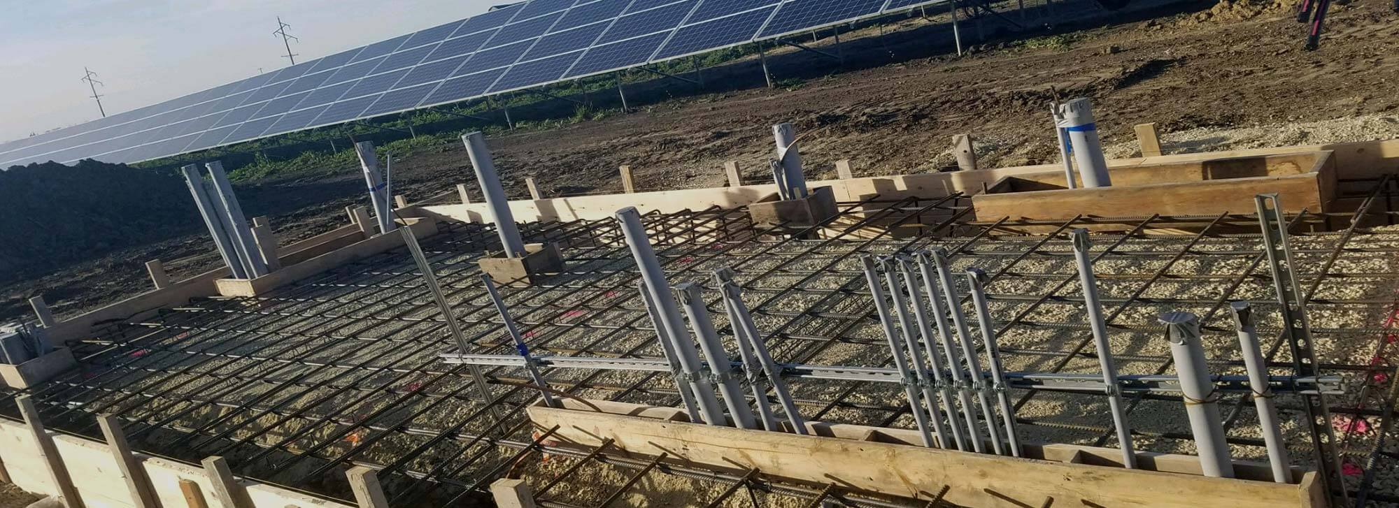 Concrete platform frames for a solar panel farm prepped and ready for concrete to be poured by Van Haren Construction